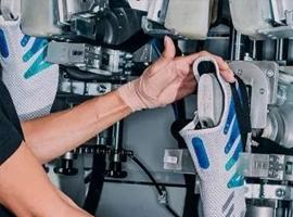 自动化让阿迪年造百万双鞋 45家创企扎堆机器人