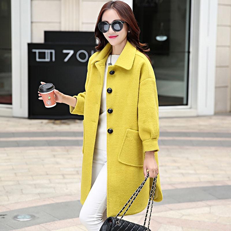 自由鸟女装欧式风尚风衣品牌折扣批发市场